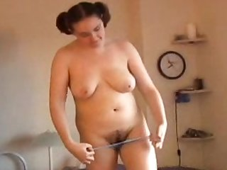 Very fat girl is lying naked and masturbating