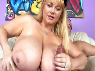 Busty blonde is sucking a horny dick