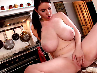 Hardcore brunette Karina Heart shows her giant boobies
