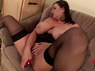 Sweet busty brunette Marille is getting a dildo in her pussy