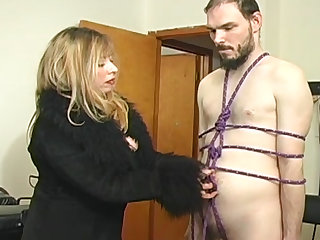 Leather mistress dominates tied up guy