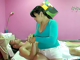 Busty Asian masseuse sits on his cock