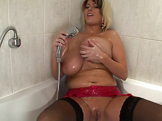 Sweet blonde shows off her giant melons in the shower