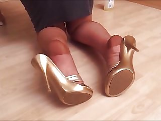Heel Popping In Tan Stockings While Cleaning Floor